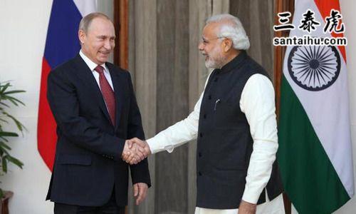 俄罗斯总统普京和印度总理莫迪在握手